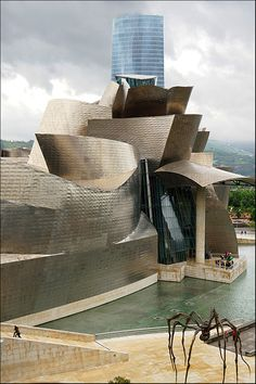 Frank Gehry's Guggenheim Museum in Bilbao, Spain. The spider sculpture is by Louise Bourgeois.