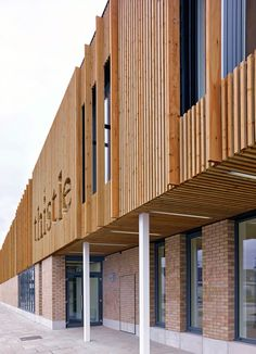 Thistle Foundation, Centre of Health & Wellbeing, Edinburgh, by 3DReid. Timber cladding, brick and pre-cast concrete to exterior. Carved feature signage. Photography courtesy of Cadzow Pelosi.