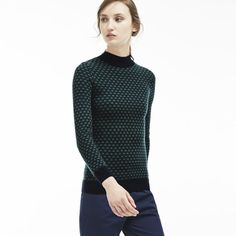 Bold style in the form of a warm turtleneck sweater crafted in wool mini jacquard and enhanced with a graphic print and contrast ribbing. Great with dark jeans.