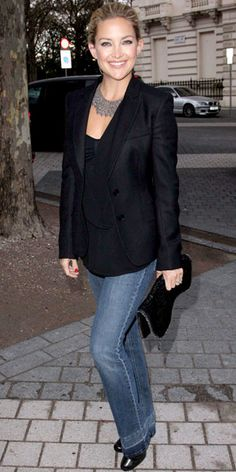 Hudson hit a London cocktail party in flared jeans that she paired with black accents including a tailored blazer and Stella McCartney envelope clutch.