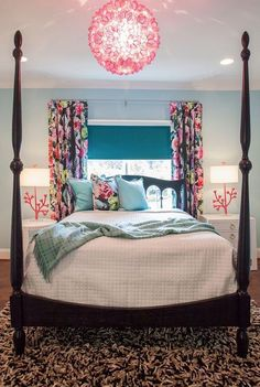 love the pops of color in the curtains, lamps & pillow (and of course that chandi)