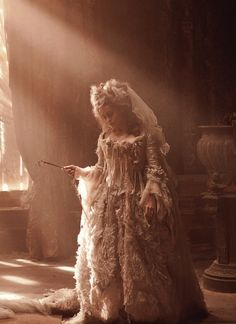 Miss Havisham, her gown is indescribably beautiful  !!!!!!!!!!!!!!!!!!!!