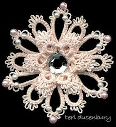flower brooch done by stacking tatted motifs.  i love the design; but pattern may need to be retested since i did not try this yet.