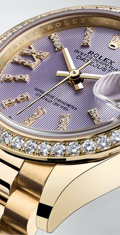 The Rolex Lady-Datejust 28 in 18ct yellow gold with a diamond-set bezel and lilac dial.