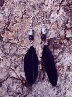 These beautiful earrings were handcrafted with real black feathers and crystal amethyst beads.   Measurements: Length: 3.5 inches