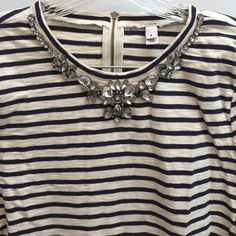 "J Crew Top with bling (blue and cream) This top has blue stripes. All the bling is in place. It does make a jingle noise on the hanger but I don't know if it does when wearing it. 25"" length 16"" under arms across  sleeves are 18"" zipper in the back perfect condition J. Crew Tops"