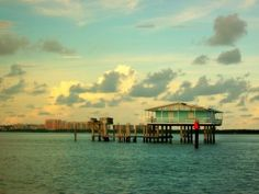 House on stilts in ocean, part of 7 total called Stiltsville. They are part of Biscayne National Park in Fla. a few miles from Miami and can be rented for a weekend or week. Pretty cool!. Only way to house is by boat.