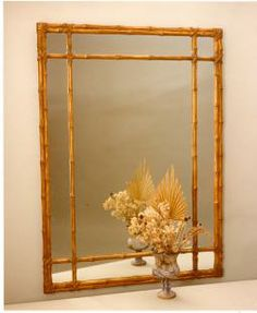 Turned bamboo mirror from Carvers Guild, offered here in their antique gold finish with plain mirror. Can be hung vertically or horizontally.