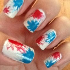 July 4th Nails - while the white polish was still wet, I placed a drop of red and dragged a straight pin out from the middle of the dot then repeated with the blue. Do each nail individually, as it is important that the polish underneath is still wet. (Notice how my middle finger looks more like a blob, due to the white being a bit dry.)  Looks like fireworks! :)