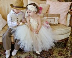 Darling flower girl and ring bearer outfits.