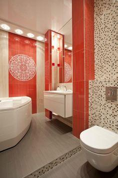 carrelage de couleur corail et une belle mosaïque dans la salle de bains