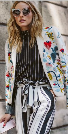 Who made Olivia Palermo's floral embroidered jacket, sunglasses, black stripe top, and white stripe pants?
