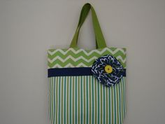 Items similar to Large Blue Green Tote lined with pockets inside, Heavy duty fabrics, Cute fabric flower with button on Etsy Small Sewing Projects, Sewing Crafts, Homemade Bags, Patchwork Bags, Fabric Flowers, Blue Green, Reusable Tote Bags, Pockets, Unique Jewelry