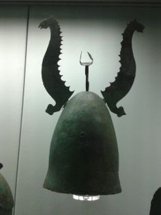 Bronze helmet with crest-holder and detachable horns in the form of horse-headed sea-monsters. About 325-275 BC
