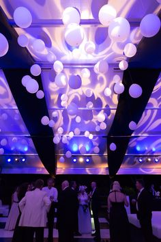 Decorations for the tent roof at a black and white gala.