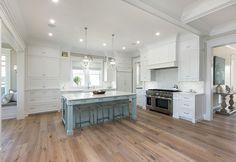 white kitchen with blue island | Mahshie Custom Homes