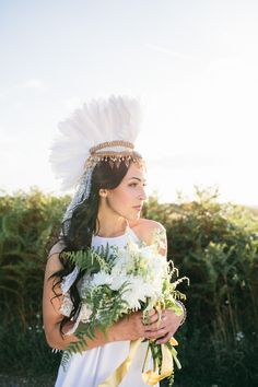 Unique Wedding Inspiration Featuring A Bride in A Feathered Headdress & A Horse - Bridal Musings Wedding Blog