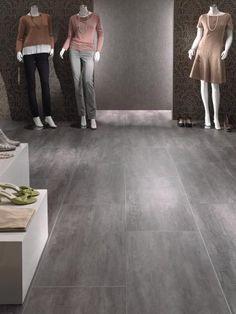 Vinylová podlaha EarthWerks, šedý beton, instalovaná v obchodě. / Vinyl flooring EarthWerks, grey concrete, installed in shop.  http://www.bocapraha.cz/cs/aktualita/46/earthwerks-vinylove-podlahy-inspirovane-prirodou/