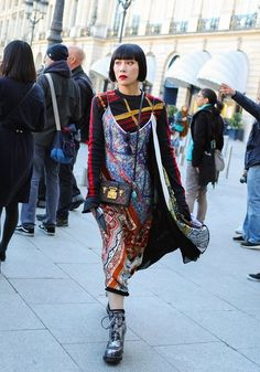 Mademoiselle Yulia with a Louis Vuitton bag spotted on the street at Paris Fashion Week. Photographed by Phil Oh.