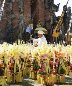 A priest blessing offerings to the gods at a temple in Bali