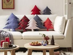 These Christmas Tree Shaped Pillows are so adorable! All it takes are two pieces of festive fabric cut into a pine tree. Then you put the right sides together and sew the seams, leaving a small hole for the stuffing. Turn the fabric tree inside out and start stuffing the cotton in. Seal it with a straight stitch and get ready to make more!