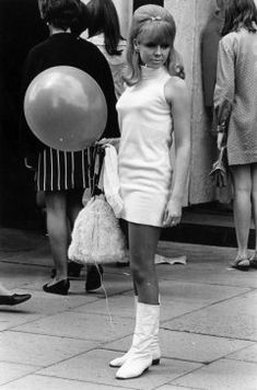 "A young woman wearing a mini dress in ""swinging"" London, 1960s. [Miniskirt styles of the '60s and '70s 