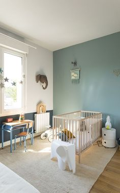 decoration celadon green baby room green white crib with light wooden bars white elephant game parquet wood carpet carpet green color wall small desk schoolboy metal blue elephant head hanging bedside table round night table nursery c Baby Boy Nursery Room Ideas, Baby Room Boy, Baby Bedroom, Baby Room Decor, Kids Bedroom, Boy Toddler Bedroom, Toddler Rooms, Bedroom Ideas, White Baby Cribs