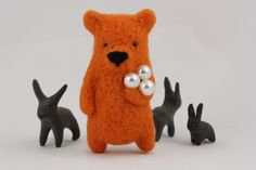 A orange bear holding pearls brooch. $37.00, via Etsy.
