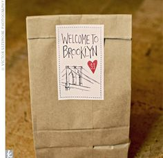 Out-of-town guests got these welcome bags sealed with a sticker of a sketch of the Brooklyn Bridge and the couple's heart logo.