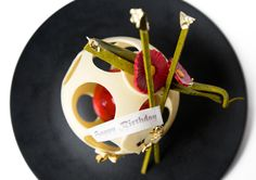 ... citrus dacquoise enclosed in a white chocolate sphere with chocolate