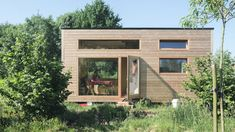 A sleek and cozy tiny house at The Pop-Up Hotel in Oostkamp, Belgium, with room to accomadate up to four people!