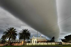 """Rare """"roll cloud""""  Photographer Rob Sharrock in 2010, over Warrnambool, Australia.  Roll clouds are a type of arcus cloud that detaches from their parent storm."""