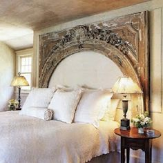 """This is a way to use a large architectural element as a """"headboard"""". I'd have added a padded, upholstered insert for better function."""