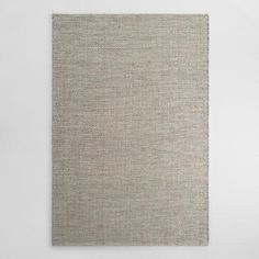 Hand woven of jute in an intricate diamond pattern with silver metallic thread adding a luxurious shimmer, our exclusive rug puts a new spin on natural fiber.
