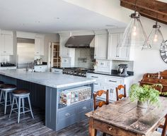 A farmhouse style sink Carrara marble countertops weathered wood floors and old barn beams complete this charming kitchen designed by #PorchPro JMKA | architects in Westport CT. Click the link in our profile to see the rest of this kitchen redesign!
