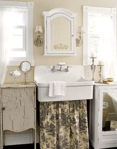 /\ /\ love the toile skirt and mixed vanity cabinets