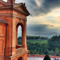 A dramatic #view over #Bologna after a dramatic climb to the Santuario della San Luca high on a hill. I never tire of the sienna and gold colors of the #architecture - Instagram by suuperg