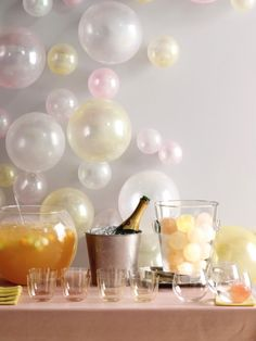 Kate's 1 year NY brunch? Originally designed for a New Years Party by the staff at Martha Stewart, I think this party provides tons of bubble fun! Pearlized latex balloons on the wall look just like bubbles! This would be perfect for an engagement party, milestone birthday party, or girl's night in champagne party!