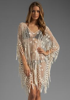 ANNA KOSTUROVA Tassel Long Poncho in Cream at Revolve Clothing