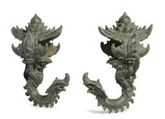 A pair of bronze palanquin hooks KHMER, ANGKOR PERIOD, BAYON STYLE, 13TH CENTURY  - Christie's