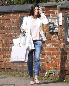 Mum on the run: Rebekah Vardy was back in her skinny jeans already as she took some time off her mum duties in favour of a spot of retail therapy at Cavells Boutique in Oakham on Thursday