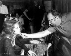 Rare still of filmmaker Sergio Leone directing actress Claudia Cardinale on the set of the classic Spaghetti Western, Once Upon a Time in the West, aka C'era una volta il West.