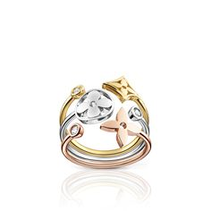 Monogram Idylle ring in white, yellow and pink gold with diamonds via Louis Vuitton