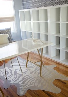 Ikea - high gloss Linnmon tabletop in white, trestle legs spray painted gold and white Expedit shelving in high gloss white