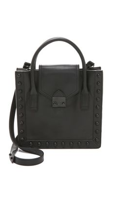 Leather-covered studs add subtle edge to this structured Loeffler Randall handbag.