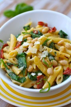 Creamy Pasta with White Beans and Spinach is an indulgent, yet simple dish. It's easy to make, and perfect for family dinner or a gathering. #vegetarian #Italian #pasta