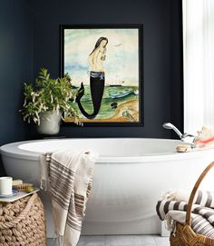 mermaids in the bathroom...(love the wall color, the tub and towel too)