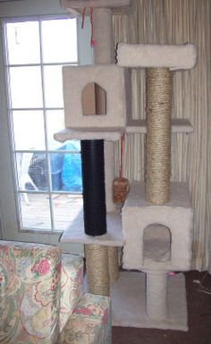 DIY cat tree tutorial! These babies are expensive and we can't wait to make our own. Love that you can customize it and pick your own fabric (totally going the organic route since my kitten loves to chew on everything).