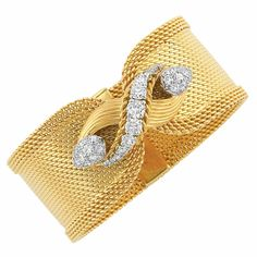 Wide Gold, Platinum and Diamond Mesh Cuff Bracelet, Mauboussin   18 kt., the wide gold flexible mesh bracelet edged by four rows of interlocking gold links, centering a ribbed figure-eight segment centering a graduating row of 11 platinum-set round diamonds, edged by twisted-gold rope, flanked by pear-shaped bombe mounts pave-set with 24 round and single-cut diamonds, altogether approximately 2.00 cts., signed Mauboussin, Paris, no. 14714, with French assay mark, circa 1950