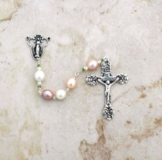 Reginas Catholic Gifts - Sterling Silver Multi-Pastel Freshwater Pearl Rosary, $199.99 (http://www.reginascatholicgifts.com/sterling-silver-multi-pastel-freshwater-pearl-rosary/)